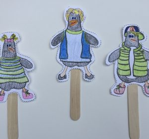 a picture of penguin puppets