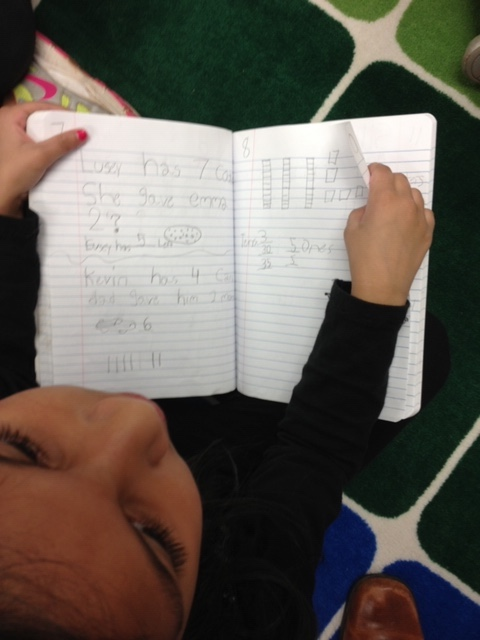 A student writing in her math journal