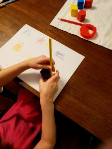 picture of child tracing shapes